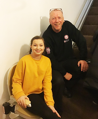 Acorn Stairlift donation delights brave Maggie-May